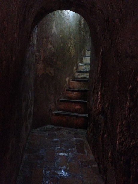 An intriguing passageway with a staircase to explore.