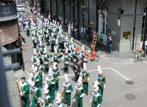 A parade coming through Royal Street