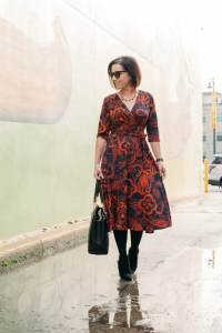 Karina dresses passport print Margaret dress styled for winter with tights and wedge booties
