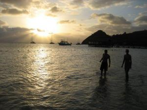 My husband & me enjoying a sunset at Sandals Grande St. Lucian.