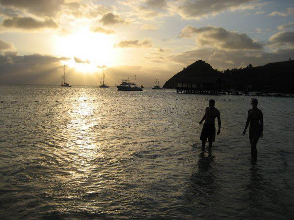My husband & me enjoying a sunset at Sandals Grande St. Lucian.
