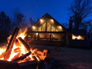 Northwoods Getaway- Private swimming pond, hot tub, & 70 acres of woods
