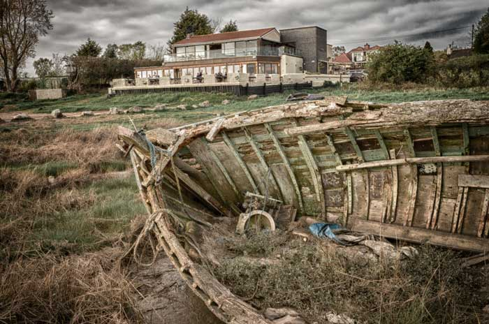A terraced restaurant overlooks the boat graveyard of Heswall