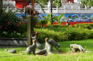 Cat scratch fever. A statuary scratching post with family of cats on the Kuching Waterfront.