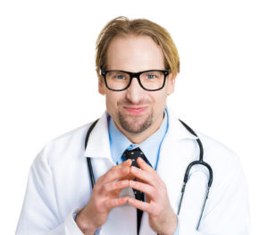 Closeup portrait crazy scientist health care professional researcher funny looking male doctor with black glasses plotting new experiment treatment isolated on white background. Human face expression
