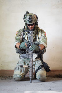 Portrait of american soldier resting from military operation