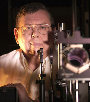 man behind laser equipment