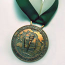 medal with official UH seal on a green and white ribbon