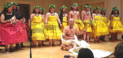 A group of hula dancers on stage