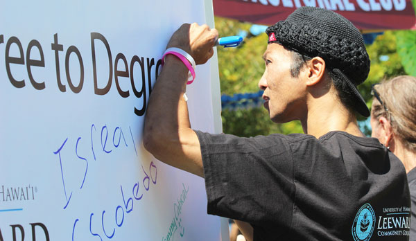 student signing