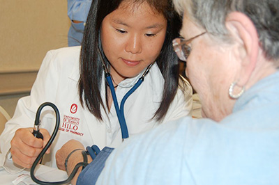 student doing blood pressure test
