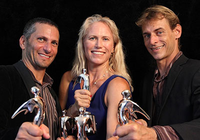 Kanesa Seraphin, center, holds a Telly Award