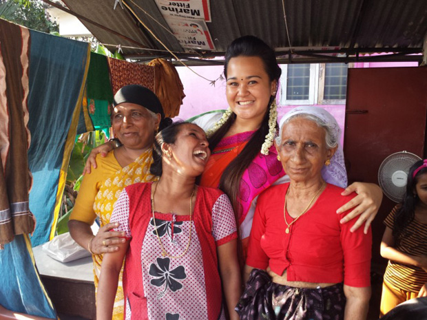 UH Hilo student Kaiulani Kamau meets a family on their stop in India