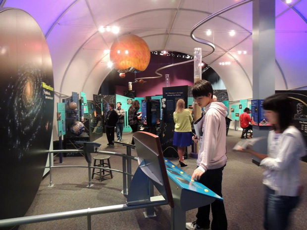 children looking at displays inside the Imiloa Astronomy Center