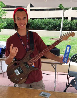 Leeward CC student Bayan Kelly received a Maker of Note distinction for his handmade electric guitar