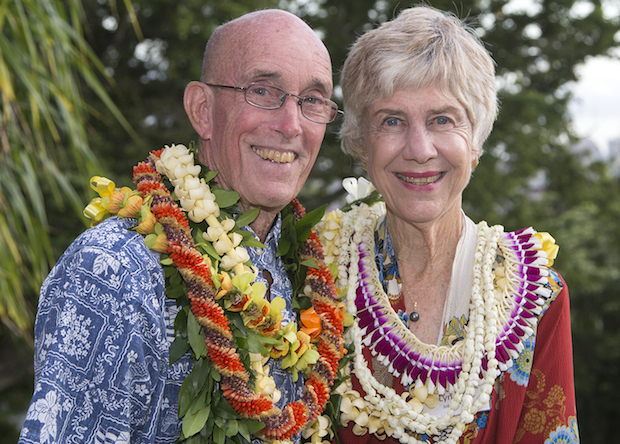 older haole couple with lei