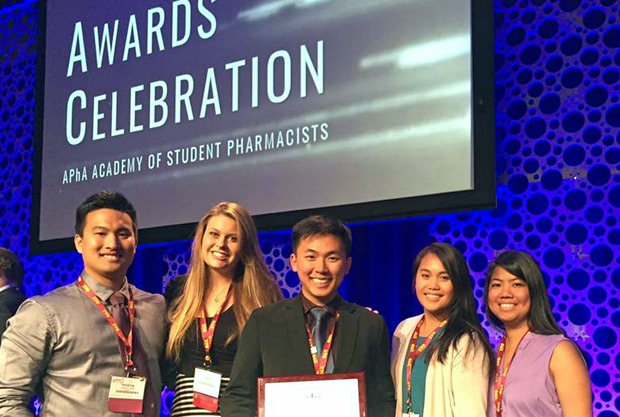 Pharmacy students accepting award