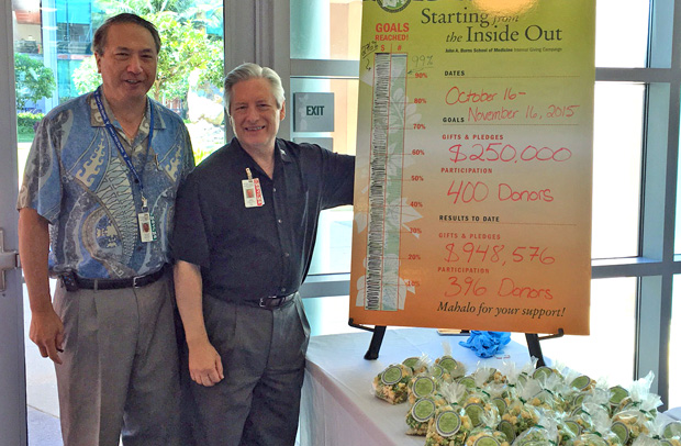 Fund drive co-chair Larry Burgess, left, with John A. Burns School of Medicine Dean Jerris Hedges at the popcorn celebration.