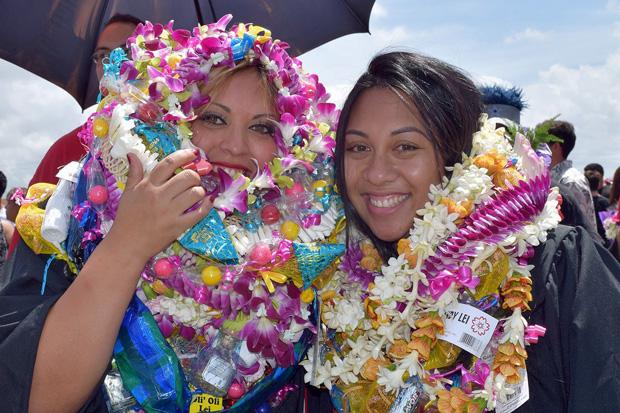 graduates with lei