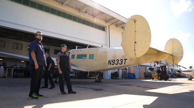 students standing next to plane