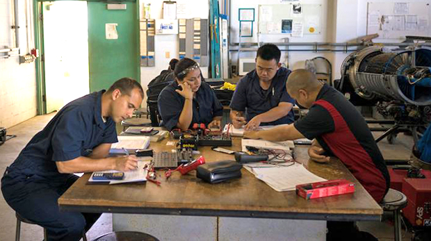 aeronautics maintenance students sitting at a table