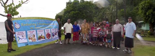 Members of the village community with a banner