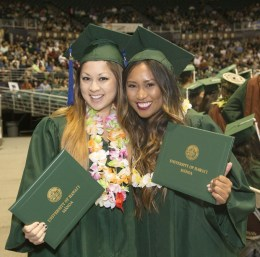 two women in graduation caps and gowns