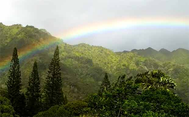 a rainbow across the mountains of Manoa Valley