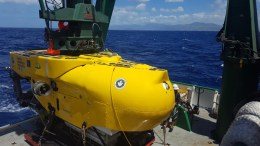 yellow sub on the deck of a vessel