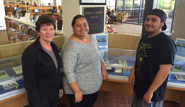 Kerri Inglis, Kaipo Wahinepio and Alana Kanahele in front of their exhibit