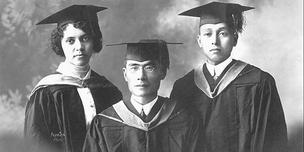 the three chemist posing in cap and gown