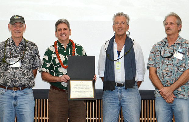 four people with sustainability award