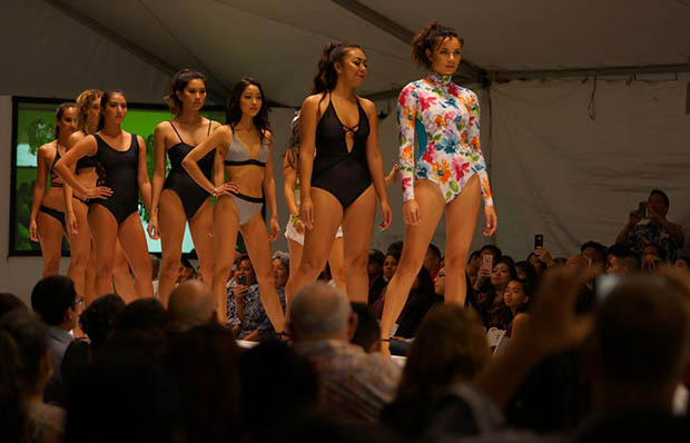 Models in swimsuits on the runway
