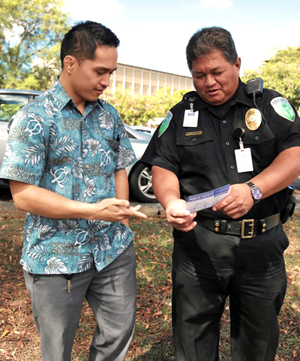 Public Safety officer helping a man
