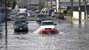 Car driving through flooded street