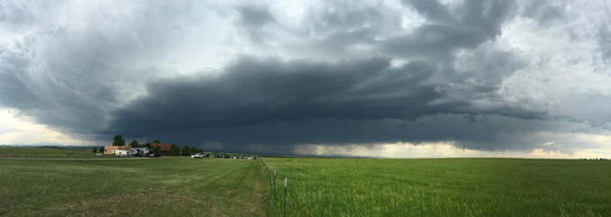 black storm clouds over farmland