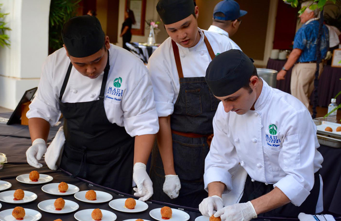 Student participants carefully plating food