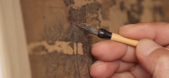 hands holding painting art brush