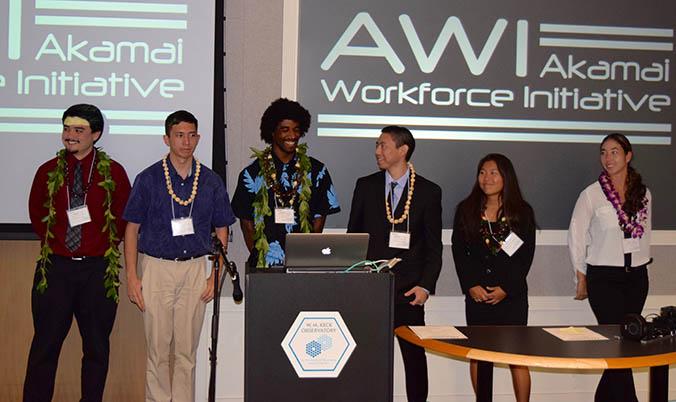 Interns standing behind a podium