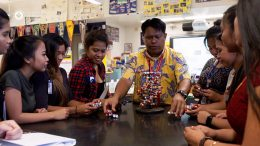 Science teacher with students in a lab