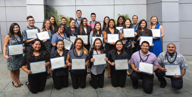Group of proud program graduates with their certificates