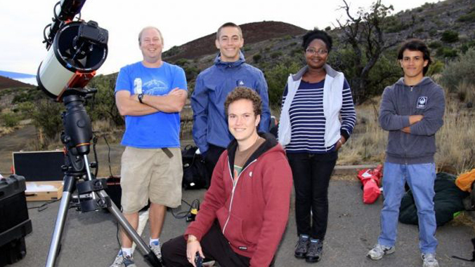 Observation team members with telescope with photo credit by John Coney.