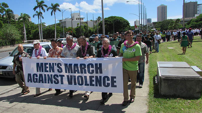 Large group of men marching against violence
