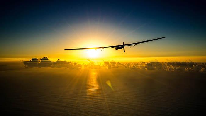 The Solar Impulse 2 flying over the ocean toward the sun
