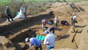 People working to excavate the worksite