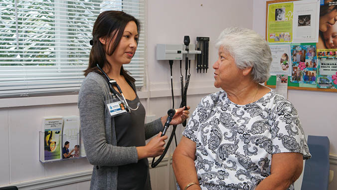 Nurse consulting with a patient