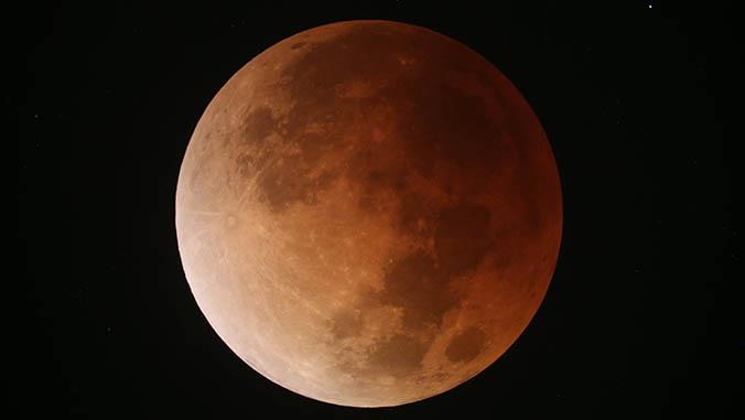 Super, Blue Blood Moon Dazzles Despite Clouds