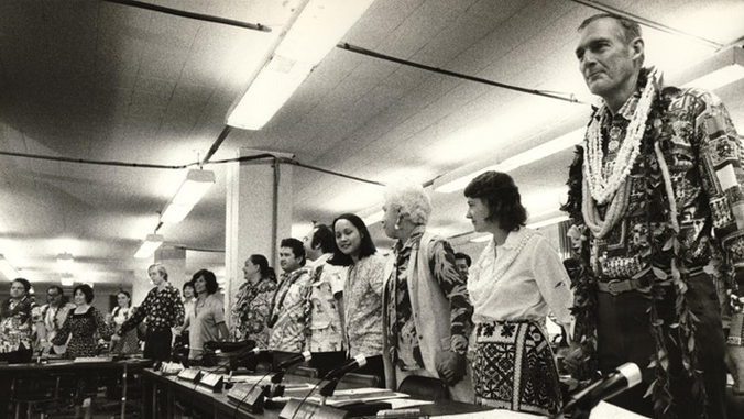 delegates standing at a table at the 1978 Hawaii constitutional convention