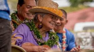 Kupuna smiling with a ukulele