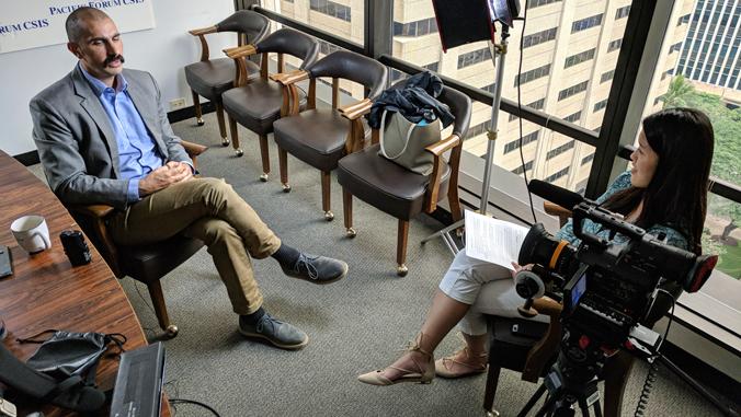 Nicole Tam interviewing someone